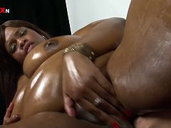 This chocolate nympho knows that she is driving her GF crazy. She spreads her legs wide indicating how bad she wants her to fist her big pussy.