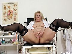 Yvonne is a whore and we like it that way. The old saggy nurse makes her time to self satisfy and we get to see how. The blonde slut undresses, takes a sit on the gynecologist chair and spreads her thighs really wide. See her tight, shaved pussy? What will she do with it for us?