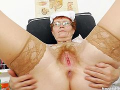 Jindriska is a filthy granny nurse, that loves to play with her saggy pussy now and then. When this old whore has a moment to spare, she makes herself comfortable on the gynecologist table, spreads her legs and then her pussy lips. She gives us a perfect view of her hairy snatch, but will she offer us more than that?