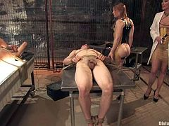 Madison Young and Maitresse Madeline are having fun with a few men in a basement. The skanks bind the guys and then torture them and drill their brown eyes with strapons.