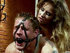 Kinky Felony ties up and gags Trent Diesel. Later on she destroys his ass with a strap-on. This nasty blonde also sits on his face and he licks her vagina.