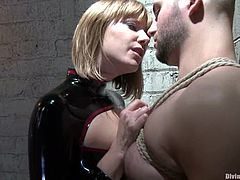 Nasty mistress ties the guy up and fixes claws to his nipples. Then she sits on his face and destroys his ass with huge strap-on.