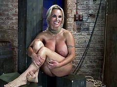 Big tittied blonde chick gets oiled up and tied up by a couple. Later on she gets her tits twisted and pussy toyed with big dildo.