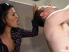 Cole Conners the sexy teacher undresses the guy and ties him up. Later on she whips him painfully and tortures his balls with clothespins. In addition she drills his ass with a strap-on.