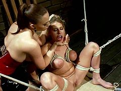 Chanel Preston and Charisma Cappelli are playing BDSM games in a bedroom. The dominatrix binds the slave and cuts her lingerie and then toys her vag and smashed it with a strapon.