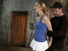 Skinny blonde girl gets tied up and undressed by two men and Isis Love. Later on Emma gets slapped and dominated by her mistress.