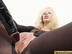 Alluring blonde in black pantyhose loves to masturbate in a very hot and kinky solo.Watch this hot and sexy blonde babe covered in black nylon and riding huge black dildo.