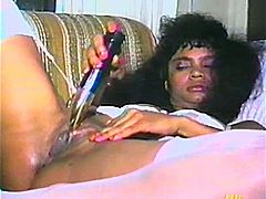 Fugly black chick is having fun with some dude in a vintage scene. She sucks and rubs the stud's boner devotedly and then drills her poontang with dildos.