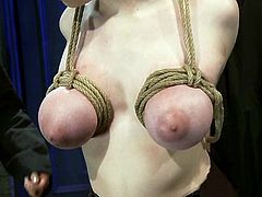 Hot Iona Grace gets undressed and then tied up. She gets her big boobs twisted with ropes and then brunette girl toys her pussy.