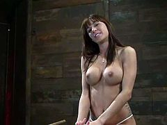 Stunning Gia Dimarco lies on wooden chest with her legs wide opened being tied up. Some guy toys her hot ass and pussy.