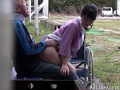 This nasty nurse helps to her patient on a walk. After some time she starts to kiss with old dude and suck his cock. Later on she lifts her skirt up and gets fucked from behind.