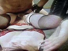 Pretty pale blonde cougar with nice tits and great body figure in fishnet stockings and leather boots get stuffed with huge meaty cock in awesome role play on vintage footage.