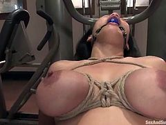 Adorable brunette gets undressed and tied up by her fitness instructor. After that she sucks a cock and gets her vagina drilled.