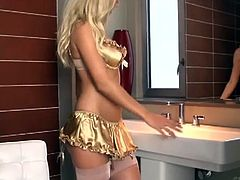 Chikita is a super hot escort girl with amazing ass and big pair of tits. She is alone in the bathroom and starts slowly to move her body and teasing her fans.