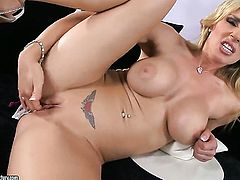 Blonde Tanya Tate with massive knockers shows her love for pussy stroking