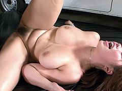 Charming Japanese bombshell amazes with her massive booty and her king sized glorious rack. One Asian guy furiously fucks her hairy drooling pussy missionary style making her cum hard.