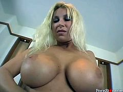Marvelous busty blondie with monster booty Devon Lee poses on cam