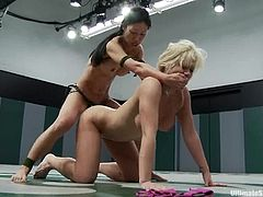 Sexy Holly Heart gets toyed rough by Tia Ling after fighting