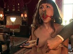 Bella Rossi and Cherry Torn get gagged with bondage mask and tied up. After that they get their pussies clothespinned.