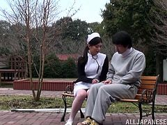 Walking time with that horny Japanese nurse. She takes her patient's dick out and sucks it. Then he penetrates her on the bench.