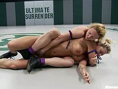 Darling and Holly Heart are having a fight on tatami. The blondes beat each other furiously and then the winner destroys the loser's pussy with a big strapon.