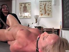Hot blonde girl gets her ass spanked with a ruler by her teacher. After that she gets tied up and pounded with a strap-on.