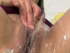 Dirty gals are enjoying warm pissing session as well as rough masturbation to one another