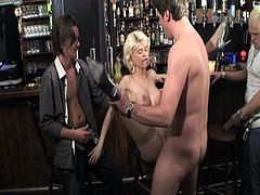 This blonde bitch gets pounded in a bar by around four guys. They break open her shaven cunt and feel the warmth of her mouth with their cocks. They finish on her face.