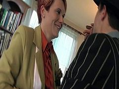This redhead milf with short hair from the Czech Republic teases a man who is sitting on a couch and smoking. He responds to her advances and he drills in her ass hole.