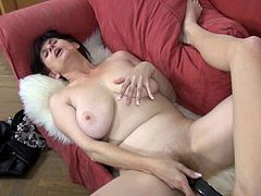 Black haired granny with giant tits invites her hot blonde girlfriend to take scissors pose in order to share that giant double ended dildo.