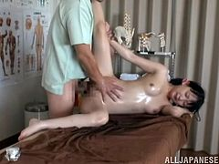 This cute Asian chick is at a massage saloon. Her masseur doesn't let her wait for too long and begins to rub her. He puts his hand between her hot thighs and rubs her pussy so hard that she moans and scream with pleasure. Next he takes out his dick to massage her pussy on the inside and cums inside her.