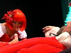 Sandra Romain gives a blowjob to a guy in Santa costume