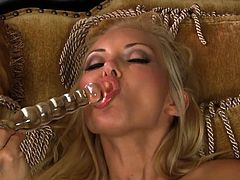 Alluring pornstar Aaliyah Love loves stroking her wet vag with this big glass toy