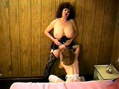 Black haired retro mommy with thick booty and massive natural tits in lingerie eats her tight girlfriend's soaking coochie. Then chubby MILF lies on her back and gets her big hairy pussy eaten as well.