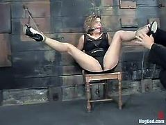 Nasty blonde girl takes her clothes off and gets tied up with ropes. After that this girl sucks big dildo and gets toyed from behind.