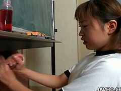 Innocent looking asian teen shows her jerking off skills in this video as she gets on her knees and jerks off a guy under the table. Cum inside and watch as this kinky handjob scene!
