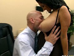 Brunette mommy with natural king sized tits exposes her rack for her bald lover. Dude plays with her massive tits and gets his meat pole sucked.