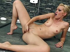 Blonde Sophie Moone does striptease before she sticks her fingers in her muff