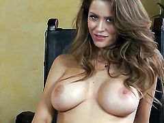 Emily Addison with gigantic boobs and shaved bush touches her knockers playfully