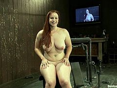 Chubby bitch Bella Rossi strips and lets some man chain her in a basement. The dude plays with Bella's massive tits and then fucks her snatch to orgasm with a dildo.