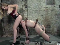 Tied p Trinity Post gets whipped and pinched with claws. After that she gets her ass fingered and toyed with a strap-on. Then she also gets toyed with a vibrator.