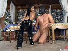 Asian mistress puts the mask on her sex slave and ties him up. Later on he sucks a strap-on and gets whipped.