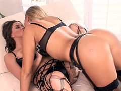 Two stunning MILFs in sexy lingerie lie on a sofa and kiss. Then they lick each others juicy boobs and pussies. Of course they also use their nimble fingers.