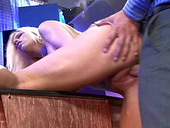 Attractive blonde doll Britney Amber with big round firm balloons and sexy tattoo on lower belly gets nailed by Rocco Reed all over the office in awesome role play.