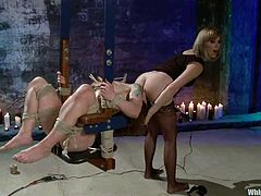 Tattooed brunette girl gets fingered and tied up by a mistress. Then she also gets clothespinned and whipped. Of course then she gets toyed with a strap-on.
