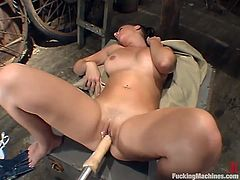 Hot brunette Penny Flame is getting naughty in a barn. She plays with her juicy pussy and then takes a ride on a fucking machine.