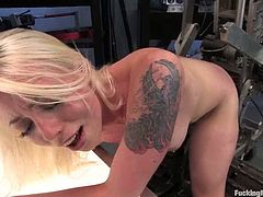 The sexy tattooed blonde Lorelei Lee is a very kinky one. And today she's enjoying herself as she's fucked hard by machines.