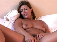 Lusty milf shows off while stretching her shaved twat in hot solo cam show