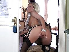 Niki Young with giant knockers and bald twat has some time to stroke her bush
