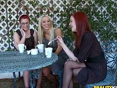 Three girls have a tea in the arbor. After some time this tea party turns to lesbian threesome sex. These girls lick each others pussies lying on a table.